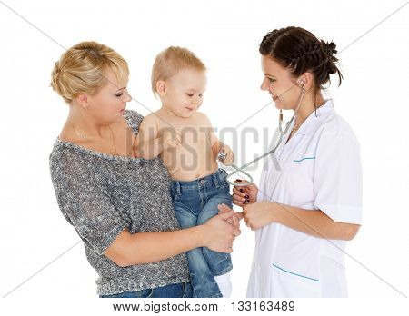 The female doctor with a stethoscope and  young mother with little son stand on a white background. Healthcare.
