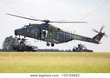 BERLIN / GERMANY - JUNE 3 2016: tactical troop helicopter NH90 from nato helicopter industries flies in berlin germany on june 3 2016.