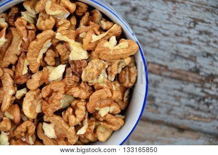 Walnut Kernels In Cup Organic Tree Harvest Blue Wood Texture 2