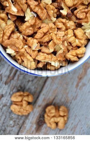 Walnut Kernels In Cup Organic Tree Harvest Blue Wood Texture 3
