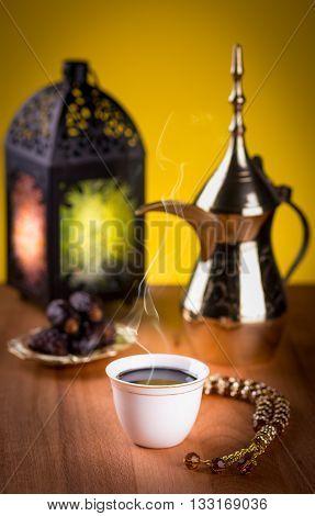 Arabian coffee with dates and Ramadan lantern