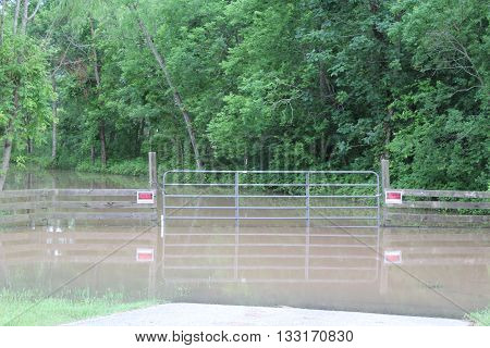 WEST COLUMBIA, TEXAS - JUNE 3, 2016 : The Brazos River has risen out of it's bank in West Columbia, Texas.  The widespread flooding in Brazoria County continues as heavy rains fall.
