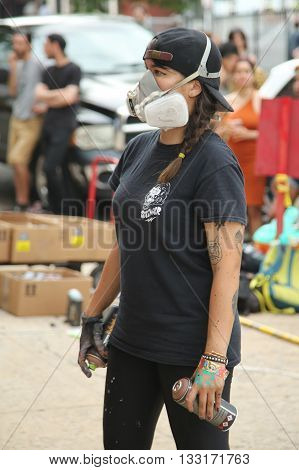 NEW YORK, - JUNE 4, 2016: Unidentified street artist in gas mask during Bushwick Collective Block Party in Brooklyn, New York