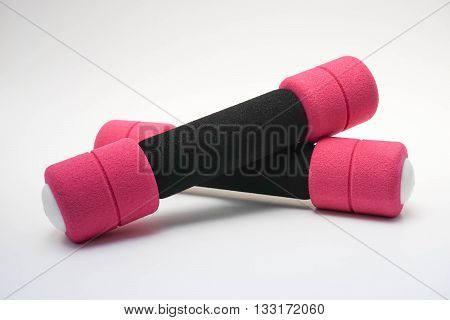 Pink-black dumb bell for woman in white background
