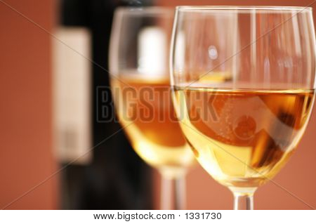 Two Wine Glasses And A Bottle A Wine