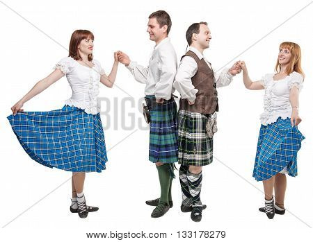 Two pair of dancers of Scottish dance isolated