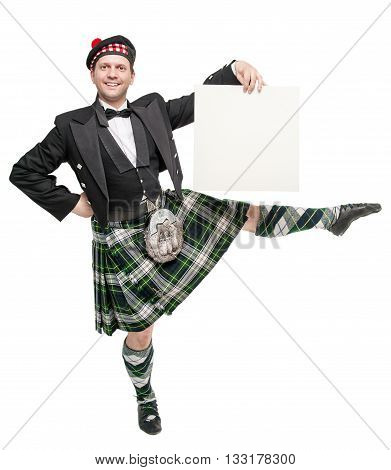 Young Man In Clothing For Scottish Dance With Empty Banner