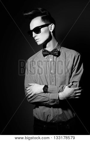 Fashion studio shot of a handsome male model with stylish hair. Male haircuts. Beauty, fashion.