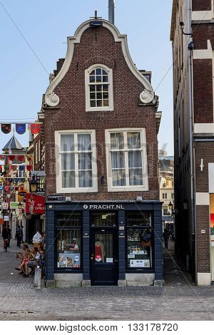 UTRECHT, NETHERLANDS - MAY 6, 2013: This is one of the typical old Dutch houses in the city lost like many other its vertical position.