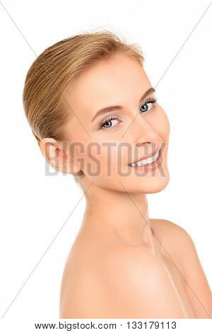 Portrait of a beautiful smiling young woman with natural make-up. Spa girl. Skincare, healthcare. Healthy teeth. Studio shot. Isolated over white.