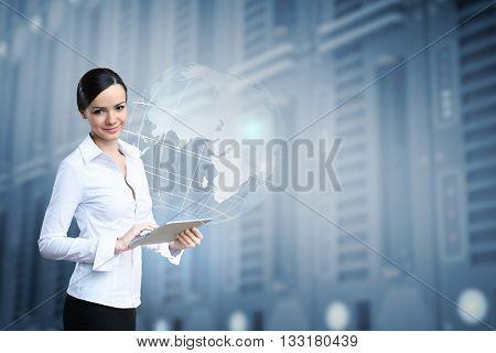 Elegant woman using tablet pc