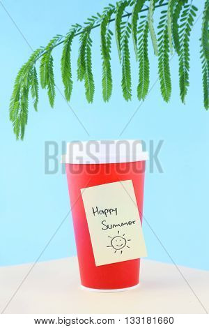 Coffee to go. Paper coffee cup with good happy summer yellow stick note
