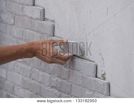 Worker Install Stone Wall Tile With Cement For House