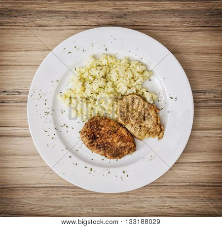 Tasty pork tenderlion with rice on the white plate. Food theme. International cuisine. Restaurant menu.