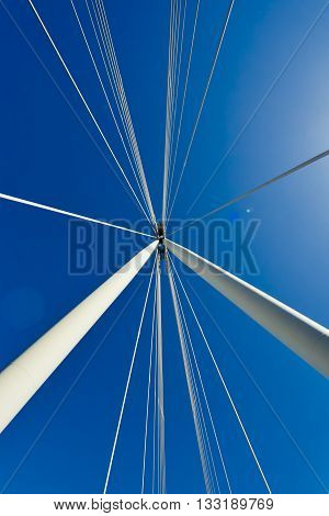 London Hungerford bridge detail at blue sky background