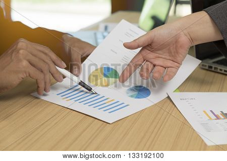 Businessman Discussing With Document, Pen, Laptop Computer