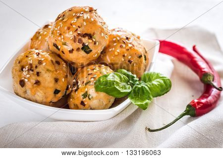 Chicken Meatballs Under Sweet Chili Pepper Sauce