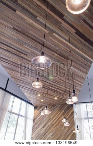 Lantern On Slant Wooden Wall With White Curtain