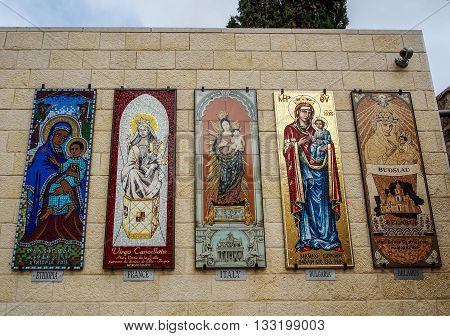 NAZARETH ISRAEL - MARCH 24: Mosaic panels depicting the Virgin Mary Basilica of the Annunciation in Nazareth Israel on March 24 2016