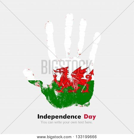 Hand print, which bears the Flag of Wales. Independence Day. Grunge style. Grungy hand print with the flag. Hand print and five fingers. Used as an icon, card, greeting, printed materials.