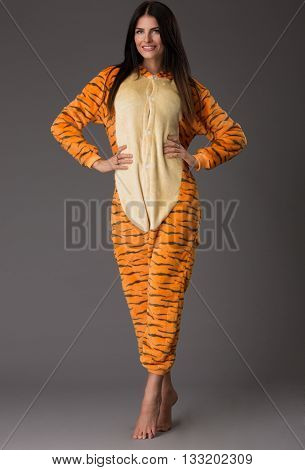 Happy woman in pajamas over greu background