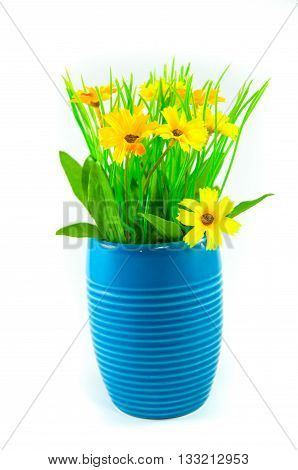 yellow artificial flowers in a blue vase