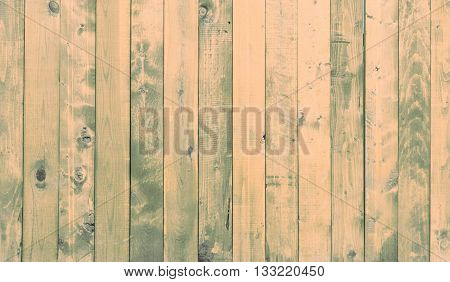 Background with colored vertical wooden planks in yellow