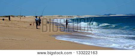 Fishing on the beach (Stockton, NSW, Australia)
