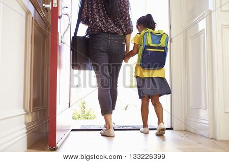Close Up Of Mother And Daughter Leaving For School