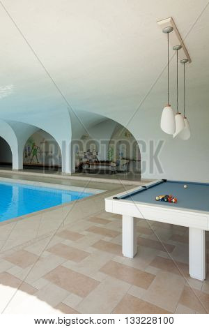 Luxury house, indoor swimming pool with billiard