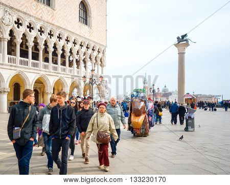 VENICE, ITALY - March 16, 2016.Tourists foot Street in Venice. its entirety is listed as a World Heritage Site, VENICE, ITALY.