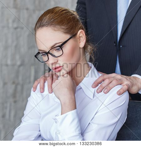 Boss put hands on secretary shoulder in office