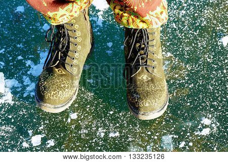 beautiful woman ethno shoes on ice lake