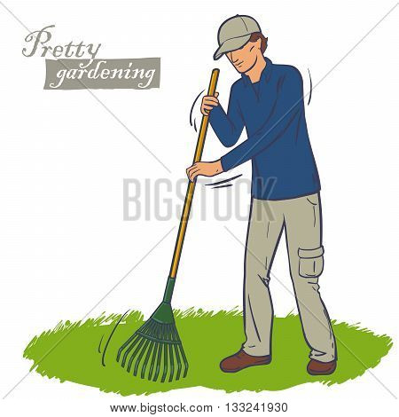 The man in the cap works a rake in the garden. Cleaning green lawn. Lawn care.