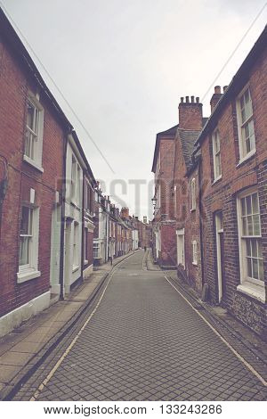 WINCHESTER, UK - FEBRUARY 07, 2016: Narrow street architecture with typical english brick buildings and architecture. Winchester, UK on February 07, 2016.