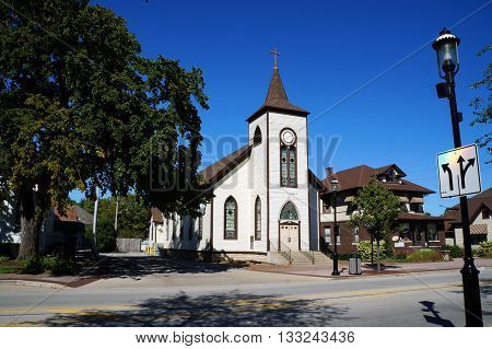PLAINFIELD, ILLINOIS / UNITED STATES - SEPTEMBER 20, 2015: The former St Mary's Catholic Church, originally built as a Universalist church in 1836, now abandoned in downtown Plainfield.