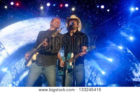 NEW YORK-JUN 27: Country musician Brad Paisley (R) performs onstage at the 2015 FarmBorough Festival - Day 2 at Randall's Island on June 27, 2015 in New York City.
