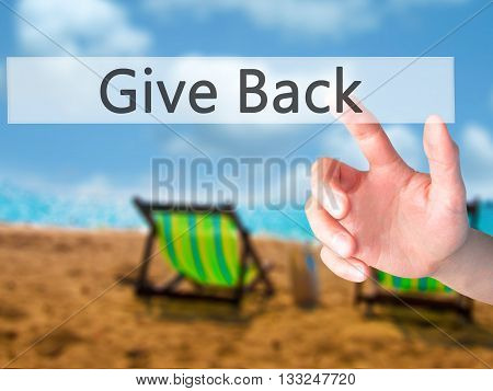 Give Back - Hand Pressing A Button On Blurred Background Concept On Visual Screen.