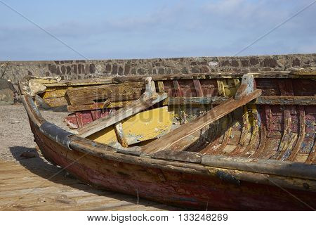 Derelict wooden boat on the quayside in the fishing harbour of Antofagasta in northern Chile.
