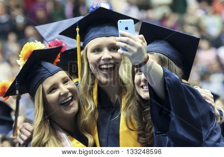 FLAGSTAFF, ARIZONA, MAY 13. Northern Arizona University on May 13, 2016, in Flagstaff, Arizona. A trio of young women at their Northern Arizona University Commencement 2016.