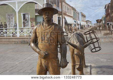 ANTOFAGASTA, CHILE - MAY 16, 2016: Statue of a man and a mule dedicated to the nitrate miners of the 18th and 19th centuries whom provided the foundation for the city of Antofagasta in Chile.