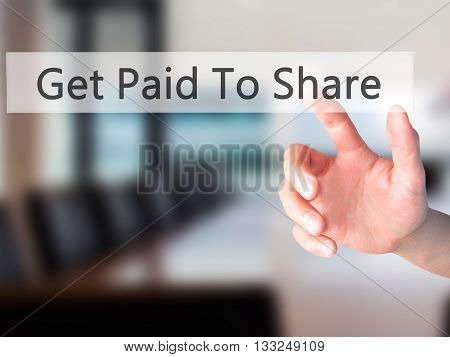 Get Paid To Share - Hand Pressing A Button On Blurred Background Concept On Visual Screen.