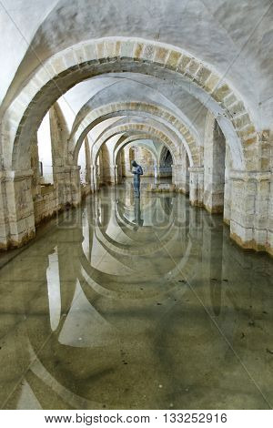 Winchester, Hampshire, UK - February 07, 2016: The flooded Crypt of Winchester Cathedral containing the sculpture