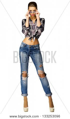 Youn girl in blue jeans isolated