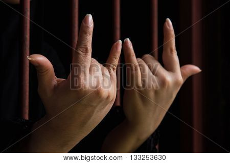 Close up hand of muslim woman post love sign hang on iron bar in jal.