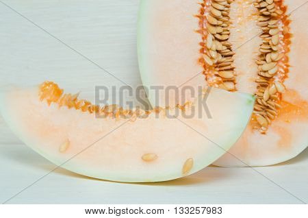 Melon or cantaloupe sliced on wooden board with seeds (Other names are Melon cantelope cantaloup muskmelon cantaloupe mushmelon rockmelon sweet melon Persian melon spanspek)
