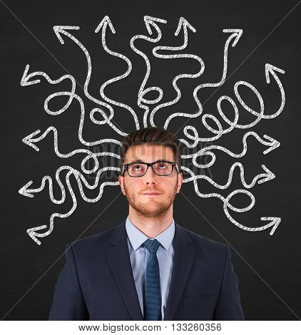 Confused businessman - people feeling confusion and chaos. Indecisive, disorientated and bewildered man stressed with headache over decision making. Young Man on chalkboard background
