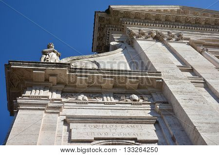 Basilica of Santa Francesca Romana facade beautiful baroque friezes, designed by architect Lambaldi in the 17th century