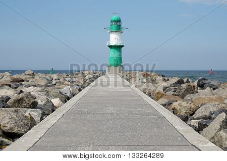footpath on pier leading to breakwater light or beacon at Rostock Warnemunde, Germany