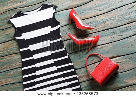 Black and white evening dress. Glossy heels and sleeveless dress. Lady's new leather purse. New merchandise on auction. poster